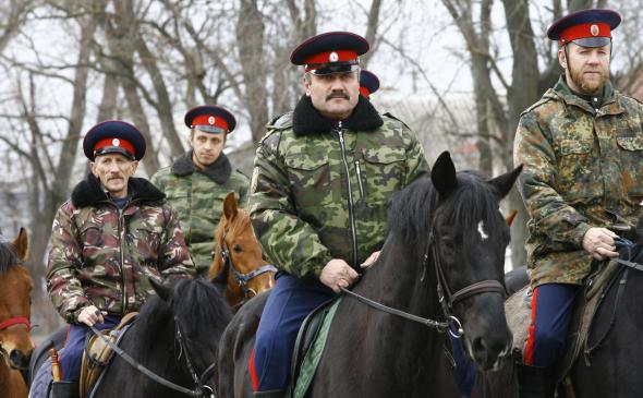 479535495-mounted-cossacks-patrol-an-area-near-russian-ukrainian.jpg.CROP.promovar-mediumlarge