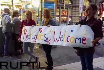 Refugees-Welcome-sign-germany-RuptlyYoutube-618x416