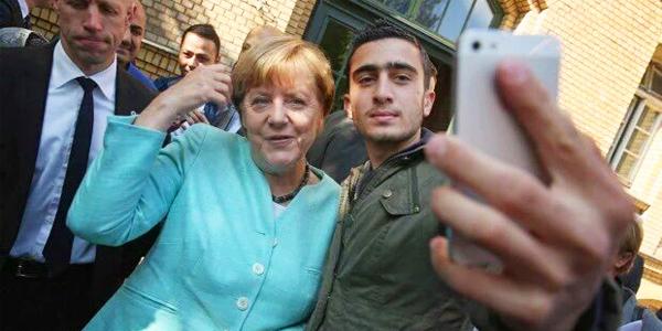 Merkel-refugee-TW.jpg
